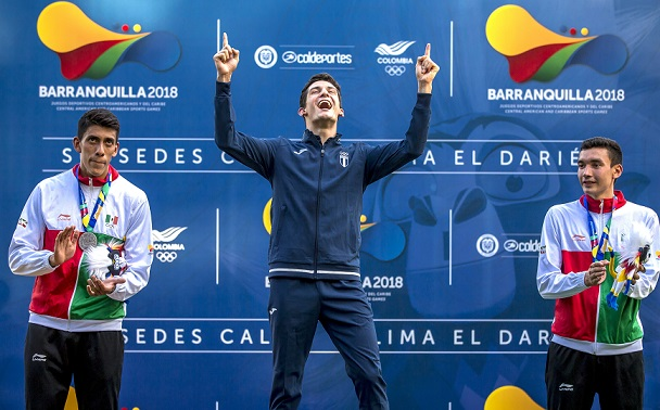 """Manuel Padilla de México (left) winner of the silver medal accompanies on the podium Charles Fernández de Guatemala (center) gold medal winner and Juan Pérez (right) winner of the bronze medal in the Men's Modern Pentathlon competition in Cali, the city behind the XIII Central American and Caribbean Sports Games of Barranquilla, Colombia, July 21, 2018. (Photo credit should read """"Antonio Ocampo/Barranquilla2018/AFP-Services"""")"""